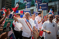 NYC Mayoral candidate William Thompson joins thousands of Dominican-Americans and their friends and supporters as he campaigns in the Dominican Day Parade in New York on Sixth Avenue on Sunday, August 11, 2013.  Politicians, flags and cultural pride were on display at the annual event. Thompson's poll numbers are at 20 percent placing him second in the field of Democratic candidates for New York mayor but 40 percent of the votes are required to avoid a run-off election. The primary election is approximately one month away. (© Richard B. Levine)