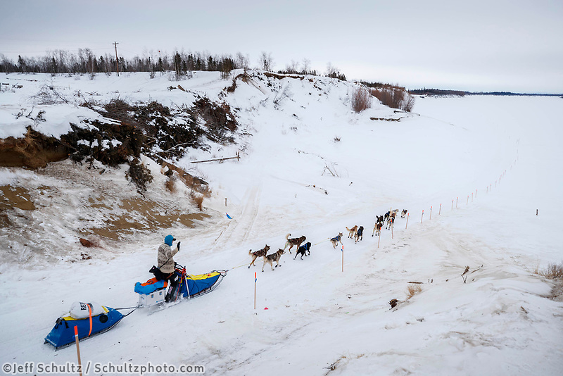 Mats Pettersson runs down the road and well-marked trail leading out of the Huslia checkpoint during the 2017 Iditarod on Saturday morning March 11, 2017.<br /> <br /> Photo by Jeff Schultz/SchultzPhoto.com  (C) 2017  ALL RIGHTS RESERVED