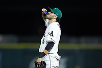 Augusta GreenJackets first baseman Frankie Tostado (8) loads up on sunflower seeds during the game against the Kannapolis Intimidators at SRG Park on July 6, 2019 in North Augusta, South Carolina. The Intimidators defeated the GreenJackets 9-5. (Brian Westerholt/Four Seam Images)