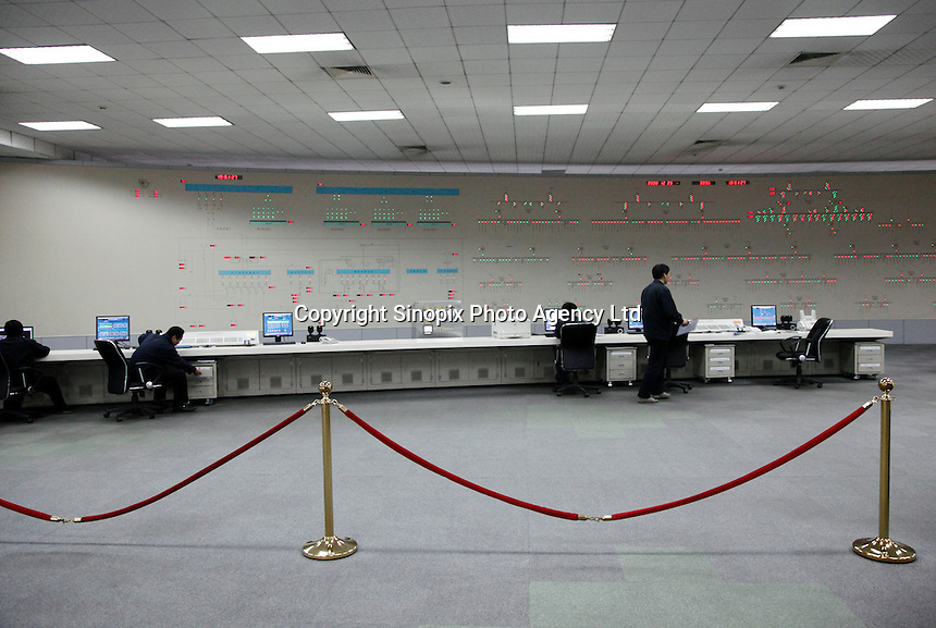 Workers in the main power control room of Ma Steel's new plant in Maanshan, China..29 Dec 2008