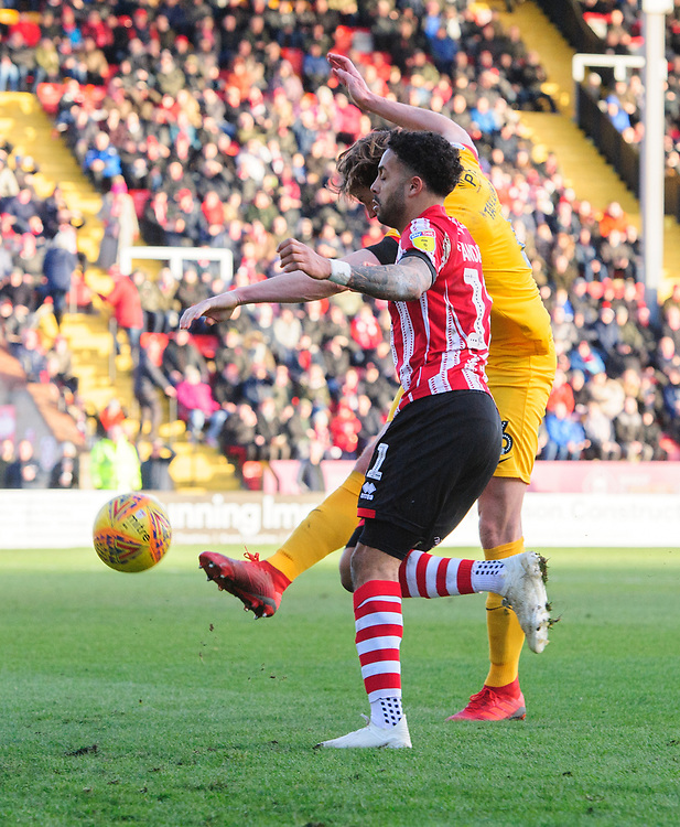 Lincoln City's Bruno Andrade vies for possession with Northampton Town's Ash Taylor<br /> <br /> Photographer Chris Vaughan/CameraSport<br /> <br /> The EFL Sky Bet League Two - Lincoln City v Northampton Town - Saturday 9th February 2019 - Sincil Bank - Lincoln<br /> <br /> World Copyright © 2019 CameraSport. All rights reserved. 43 Linden Ave. Countesthorpe. Leicester. England. LE8 5PG - Tel: +44 (0) 116 277 4147 - admin@camerasport.com - www.camerasport.com