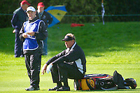 THOMASTOWN, IRELAND. Darren Clarke take's time out on the 16th fairway  waiting for the green to clear during the American Express Championship day two at the Mount Juliet Golf Club on October 1th, 2004 in Thomastown, Ireland ..Photo AFP/NEWSFILE/EOIN CLARKE..(Photo credit should read Eoin Clarke/NEWSFILE/AFP)...This Picture has been sent you under the condtions enclosed by:.Newsfile Ltd..the Studio,.Millmount Abbey,.Drogheda,.Co Meath..Ireland..Tel: +353(0)41-9871240.Fax: +353(0)41-9871260.GSM: +353(0)86-2500958.email: pictures@newsfile.ie.www.newsfile.ie.FTP: 193.120.102.198..This picture is from Fran Caffrey@newsfile.ie