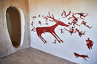 Recontructed fresco of an original found at Catalhoyuk. The men are hunting a deer and pulling on its tounge to disable it. The hunters are believed by scholors to be wearing leopard skin costumes, Painted by Mutlu Gundiler. Reconstructed houses, Catalyhoyuk Archaeological Site, Çumra, Konya, Turkey