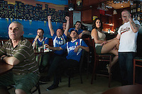New York, NY Saturday, June 14, 2014: Italian-American watch the Italy vs. England first round World Cup match in a cafe on Arthur Ave. in the Bronx Little Italy neighborhood of New York City.