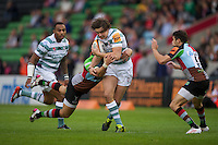 130712 Copyright onEdition 2012 ©.Free for editorial use image, please credit: onEdition..Alex Gray of London Irish is tackled at The Stoop, Twickenham in the first round of The J.P. Morgan Asset Management Premiership Rugby 7s Series...The J.P. Morgan Asset Management Premiership Rugby 7s Series kicked off again for the third season on Friday 13th July at The Stoop, Twickenham with Pool B being played at Edgeley Park, Stockport on Friday, 20th July, Pool C at Kingsholm Gloucester on Thursday, 26th July and the Final being played at The Recreation Ground, Bath on Friday 3rd August. The innovative tournament, which involves all 12 Premiership Rugby clubs, offers a fantastic platform for some of the country's finest young athletes to be exposed to the excitement, pressures and skills required to compete at an elite level...The 12 Premiership Rugby clubs are divided into three groups for the tournament, with the winner and runner up of each regional event going through to the Final. There are six games each evening, with each match consisting of two 7 minute halves with a 2 minute break at half time...For additional images please go to: http://www.w-w-i.com/jp_morgan_premiership_sevens/..For press contacts contact: Beth Begg at brandRapport on D: +44 (0)20 7932 5813 M: +44 (0)7900 88231 E: BBegg@brand-rapport.com..If you require a higher resolution image or you have any other onEdition photographic enquiries, please contact onEdition on 0845 900 2 900 or email info@onEdition.com.This image is copyright the onEdition 2012©..This image has been supplied by onEdition and must be credited onEdition. The author is asserting his full Moral rights in relation to the publication of this image. Rights for onward transmission of any image or file is not granted or implied. Changing or deleting Copyright information is illegal as specified in the Copyright, Design and Patents Act 1988. If you are in any way unsure of your right to publish this image please contact onEdition on 08