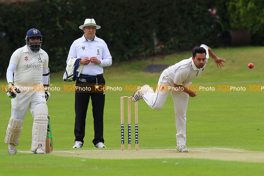 N Shaikh in bowling action for Woodford Wells during Woodford Wells CC vs Upminster CC, Shepherd Neame Essex League Cricket at Monkhams Lane on 25th June 2016