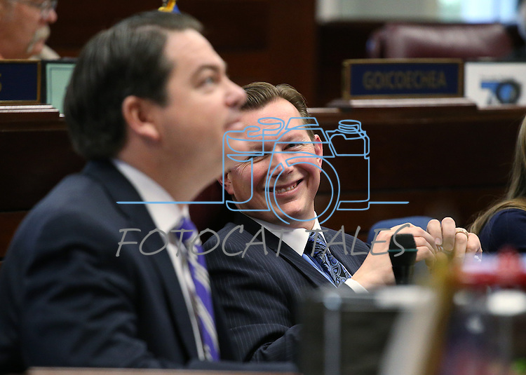 Nevada Senate Republicans Michael Roberson, left, and Ben Kieckhefer work on the Senate floor at the Legislative Building in Carson City, Nev., on Thursday, April 16, 2015.<br /> Photo by Cathleen Allison