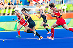 Lidewij Welten #12 of Netherlands carries the ball while Helen Richardson-Walsh #8 of Great Britain and Sophie Bray #19 of Great Britain cover during Netherlands vs Great Britain in the gold medal final at the Rio 2016 Olympics at the Olympic Hockey Centre in Rio de Janeiro, Brazil.