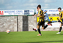 Morton's David McNeil scores their third goal.