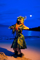 Hula dancer with full moon seeting at Makena, Maui.