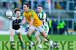Declan O'Sullivan South Kerry in action against Daragh Doherty and Shaun Keane Legion at the Kerry County Senior Football Final at Fitzgerald Stadium on Sunday.