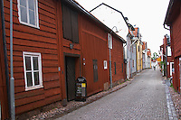 A street scene from the old town where there are many unique old wooden houses. Rukegarden Ruke (or Puke) house dating from the 15th century called the Aschan house. One of the three original manors in the town. Eksjo town. Smaland region. Sweden, Europe.