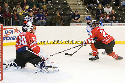 Michael Zador (Canada - 30), Jesse Mankinen (Finland - 14), Taylor Doherty (Canada - 26) - Finland defeated Canada 5-4 (so) in the 2009 World Under 18 Championship bronze medal game at the Urban Plains Center in Fargo, North Dakota, on Sunday, April 19, 2009.