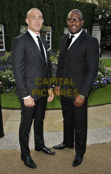 LONDON, ENGLAND - AUGUST 28: guest &amp; Ugo Monye attend the Mo Farah Foundation &quot;A Night Of Champions&quot; Dinner, The Hurlingham Club, Ranelagh Gardens, on Thursday August 28, 2014 in London, England, UK. <br /> CAP/CAN<br /> &copy;Can Nguyen/Capital Pictures