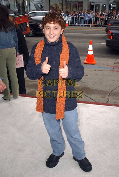 "DARYL SABARA.The Warner Brothers' World Premiere of ""Polar Express"" held at The Graumann's Chinese Theatre in Hollywood, California on .November 7th, 2004.full length, thumbs up, gesture, orange knitted scarf, jumper, sweater.www.capitalpictures.com.sales@capitalpictures.com.©Debbie Van Story/Capital Pictures"