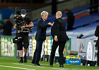 29th June 2020; Selhurst Park, London, England; English Premier League Football, Crystal Palace versus Burnley Football Club; Crystal Palace Manager Roy Hodgson bums wrists with Burnley Manager Sean Dyche in disappointed after the final whistle from the touchline as Burnley beat Crystal Palace 0-1 at Selhurst Park