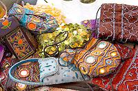 Artistic fanciful Indonesian handbags for sale at vendors booth. Dragon Festival Lake Phalen Park St Paul Minnesota USA