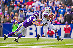 19 October 2014: Buffalo Bills cornerback Leodis McKelvin is pursued by Minnesota Vikings tight end Rhett Ellison on a kickoff during the third quarter at Ralph Wilson Stadium in Orchard Park, NY. The Bills defeated the Vikings 17-16 in a dramatic, last minute, comeback touchdown drive. Mandatory Credit: Ed Wolfstein Photo *** RAW (NEF) Image File Available ***