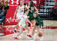 COLLEGE PARK, MD - DECEMBER 8: Sara Vujacic #32 of Maryland defends against Bri Rozzi #22 of Loyola during a game between Loyola University and University of Maryland at Xfinity Center on December 8, 2019 in College Park, Maryland.