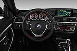 Car pictures of steering wheel view of a 2017 BMW 3-Series 330i-Gran-Turismo 5 Door Hatchback Steering Wheel