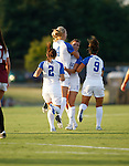 The UK Women's Soccer team celebrates after a goal off of a penalty kick in the first half that put them up 1-0 against the Eastern Kentucky Colonels at UK Soccer Complex on Friday, Aug. 24, 2012. Photo by Scott Hannigan | Staff