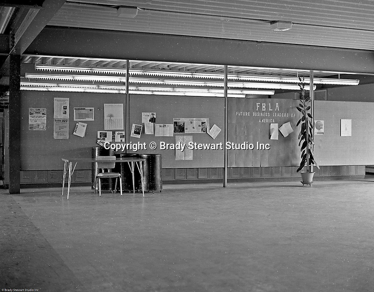 Bethel Park Senior High School:  View of Building #1's lobby before school starts - 1964. The new Bethel Senior High School was dedicated on October 23, 1960, but the campus would not grow to its current size until seven years later. Phase II of the construction was completed in 1964 with the addition of another academic building and the industrial arts building. Phase III was completed in 1967 with the construction of the fourth academic building and a 6,300 seat football stadium and track, three tennis courts, seven basketball courts and a baseball field.