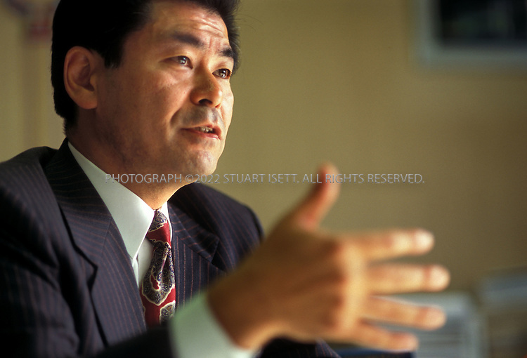 12/9/1999--Tokyo, Japan..Kenichiro Sato, member of the ruling Liberal Democratic Party of Japan, speaking in his Diet office....All photographs ©2003 Stuart Isett.All rights reserved.This image may not be reproduced without expressed written permission from Stuart Isett.