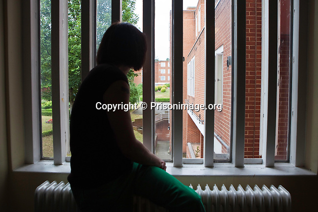 A prisoner looking out of her cell window at HMP Holloway, the main womens prison in London.