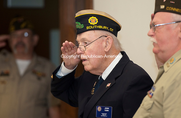 SOUTHBURY,  CT--- -053016JS14- John Turk, Commander of American Legion Post 147 in Southbury, salutes during the National Anthem during Memorial Day commemorations Monday at the Southbury Senior Center.  The annual parade was canceled due to weather concerns. <br />  Jim Shannon Republican-American
