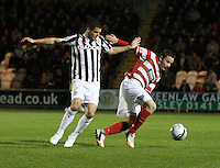 Jon Routledge challenged by Lewis Guy in the St Mirren v Hamilton Academical Scottish Communities League Cup match played at St Mirren Park, Paisley on 25.9.12.