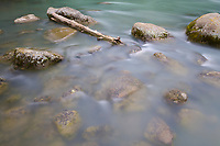 Clear water flows over stones in the Chilkoot River, Haines, Alaska