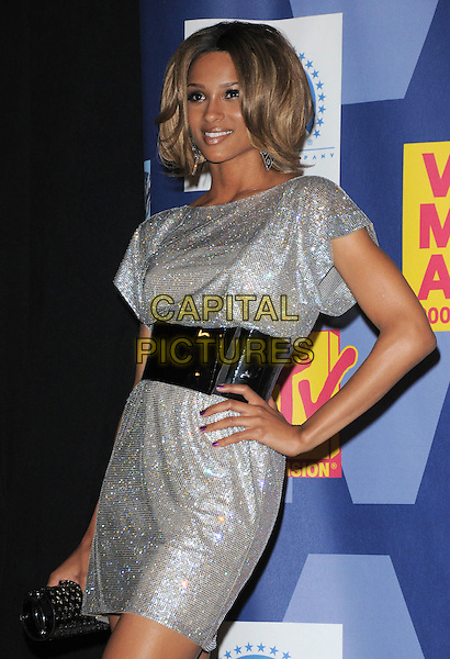CIARA.The 2008 MTV Video Music Awards held at Paramount Studios in Hollywood, California, USA..September 7th, 2008.Pressroom VMA Vmas half length silver sparkly shiny dress black belt waistband hand on hip .CAP/DVS.©Debbie VanStory/Capital Pictures.