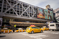 Traffic passes the depressing, crime-ridden Port Authority Bus Terminal in midtown Manhattan in New York on Tuesday, April 1, 2014. The authority has proposed building an annex on land it already owns on West 39th Street for the aging building to alleviate the traffic and parking problems. Originally built in 1950, with additional floors added in 1963 and an expansion in 1980, the building still handles many more buses than it was originally designed for.   (© Richard B. Levine)