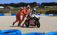Kalex Moto2 rider Xavier Simeon of Belgium is pushed by marshals during the third practice session of the Australian Motorcycle GP in Phillip Island, Oct 19, 2013. Photo by Daniel Munoz/VIEWpress. IMAGE RESTRICTED TO EDITORIAL USE ONLY