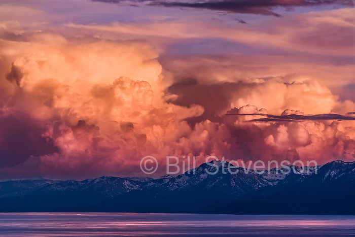 A rare event; huge thunderheads over Lake Tahoe at sunset. Summer thunderstorms are not uncommon but usually by sunset, when the suns's heat has gone, the thermals that drive the formation of the clouds, have collapsed and the clouds fade away. This had been a very hot day and thermals were still active when the light became good.