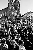 Krakow 04/2010 Poland<br /> Some 150,000 Poles bade farewell to their president and first lady Sunday in an emotional funeral service in Krakow. Mourners gathered in the squares of Krakow, waving Polish flags and wearing pins bearing Mr. Kaczynski's face and the words 'Our President.<br /> Photo: Adam Lach / Napo Images for The New York Times<br /> <br /> Zaloba po tragicznej smierci Prezydenta Lecha Kaczynskiego i jego malzonki. Ludzie zebrali sie przed Kosciolem Mariackim gdzie odbywaly sie uroczystosci pogrzebowe.<br /> Fot: Adam Lach / Napo Images dla The New York Times