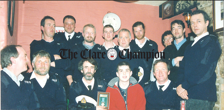 Young Peter Fitzpatrick, who was rescued by the Doolin unit of the Irish Marine Emergency Service, when he fell from a ledge at the Cliffs of Moher, pictured with members of the unit at a function in McDermott's, Doolin, where the unit displayed the bronze medal which they were presented with for carrying out the rescue. With Peter in the front row are Kevin Griffin; Tom Doherty, deputy officer; Myles Duffy and Mattie Shannon, area officer. Standing, from left: Patrick O'Brien, Brian McMahon, conor McGrath, Pearse Shannon, Ray Murphy, Danny Burke, Ritchie Jones, Ian Lambe and Johnny Murphy - May 21, 1999.