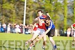 Kenmares Tommy O'Sullivan tackles Dingles Ryan Begley during their county championship clash in Templenoe on Saturday.