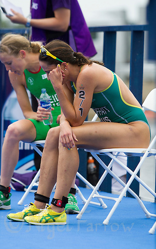 26 JUL 2014 - GLASGOW, GBR - Emma Moffatt (AUS) from Australia recovers after finishing her leg of the 2014 Commonwealth Games Mixed Relay triathlon in Strathclyde Country Park, in Glasgow, Scotland  (PHOTO COPYRIGHT &copy; 2014 NIGEL FARROW, ALL RIGHTS RESERVED<br /> *******************************<br /> COMMONWEALTH GAMES <br /> FEDERATION USAGE <br /> RULES APPLY<br /> *******************************