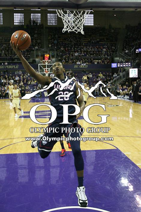 December 22, 2013:  Connecticut's Lasan Kromah goes up for a basket against Washington .  Connecticut defeated Washington 82-70 at Alaska Airlines Arena Seattle, Washington.