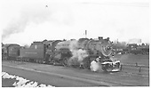 Standard-gauge D&amp;RGW #1504 at Alamosa.  #930 is backed up against #1504's tender and narrow-gauge #488 is in the background.<br /> D&amp;RGW  Alamosa, CO  Taken by Maxwell, John W. - 1/22/1940
