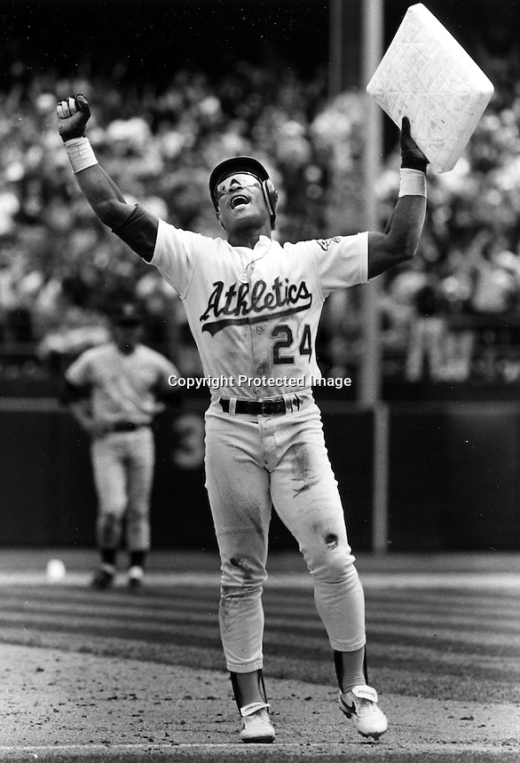 Rickey Henderson holding the bag after setting record steal.. 1991 photo by Ron Riesterer