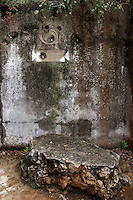 Museo all'aperto della Dolina del XV Bersaglieri, presso il monte Sei Busi. Questo Museo e' formato da tre doline (depressioni del terreno carsico). Cio' che rimane di un piccolo ospedale da campo costruito all'interno di una dolina. Sul muro buchi di proiettili<br /> The 'Dolina of the XV Beraglieri', next Mount Sei Busi. The ruins of a little hospital built into one of the carsic holes. On the wall bullet's holes<br /> Redipuglia 03-09-2014 Lungo tutto il confine del Friuli Venezia Giulia, e nella fattispecie nella zona del Carso isontino, si snoda quello che durante la Prima Guerra Mondiale, o Grande Guerra, era chiamato il fronte orientale, conteso tra l'esercito italiano e quello austro-ungarico. La zona del fiume Isonzo, obiettivo strategico, fu teatro di ben 11 battaglie e di una estenuante guerra di posizione, costata la vita migliaia di soldati. Numerose sono ancora le testimonianze di quei terribili giorni sulle colline isontine, per cui, con i patrocinio della comunità' europea, sono stati costituiti dei veri 'musei all' aperto' con percorsi che permettono di visitare i luoghi più' importanti di quelle battaglie.<br /> Along the northern borders of Friuli Venezia Giulia, Italy, was part of the called Eastern Front during the 'World War I' also said the 'Great War'. The Isonzo river, a strategic target, was theatre of 11 battles between italian and Austro-Hungarian troops, where hundred thousand soldiers lost their lives. <br /> To remember that war, a series of 'open air museums' where established, along the most important places where the battles took place and where is still possible to see trenched systems, hospitals, mass graves, barbed wire ecc.<br /> Photo Samantha Zucchi Insidefoto