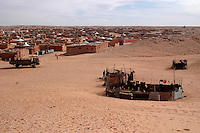 "A view of the ""February 27"" wilaya is seen on December 12, 2003. Saharawi people have been living at the refugee camps of the Algerian desert named Hamada, or desert of the deserts, for more than 30 years now. Saharawi people have suffered the consecuences of European colonialism and the war against occupation by Moroccan forces. Polisario and Moroccan Army are in conflict since 1975 when Hassan II, Moroccan King in 1975, sent more than 250.000 civilians and soldiers to colonize the Western Sahara when Spain left the country. Since 1991 they are in a peace process without any outcome so far. (Ander Gillenea / Bostok Photo)"