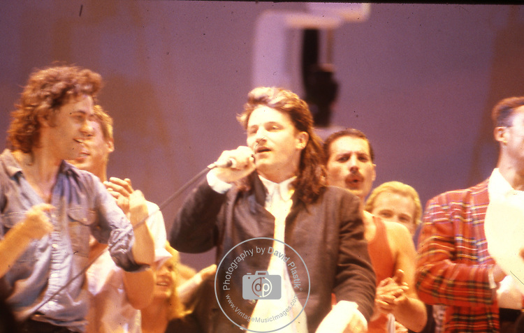 Live Aid 1985 Wembley Stadium, London , England. Bob Geldolf, Bono, Freddie Mercury, Andrew Ridgeley.