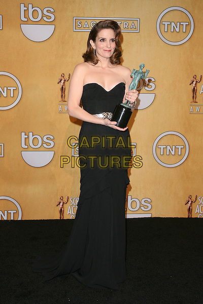 LOS ANGELES, CA - JANUARY 27: Tina Fey in the press room at The 19th Annual Screen Actors Guild Awards at the Los Angeles Shrine Exposition Center in Los Angeles, California. January 27, 2013. <br /> CAP/MPI27<br /> &copy;/MPI27/Capital Pictures