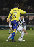 Paul Dummett closes down James Fowler in the St Mirren v Kilmarnock Clydesdale Bank Scottish Premier League match played at St Mirren Park, Paisley on 2.1.13.