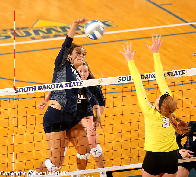 BROOKINGS, SD - SEPTEMBER 1: Heaven Harris #24 from Northern Arizona looks to get a kill past Katherine Carlson #3 from Valparaiso during their match Friday afternoon at the Jackrabbit Invitational at Frost Arena in Brookings. (Photo by Dave Eggen/Inertia)