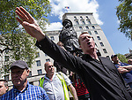 © Joel Goodman - 07973 332324 . 27/05/2013 . London , UK . EDL Deputy Leader , KEVIN CARROLL , remonstrates with anti-fascist protesters in front of the statue of Field Marshal Bernard Law Montgomery on Whitehall . The EDL march along Whitehall and hold a demonstration opposite Downing Street today (Monday 27th May 2013) . Photo credit : Joel Goodman