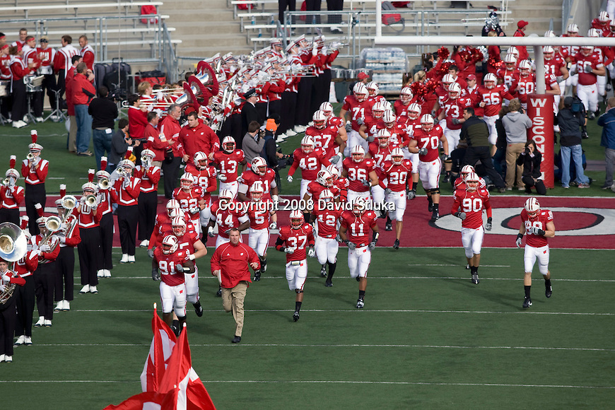 MADISON, WI - OCTOBER 25: Head coach Bret Bielema of the Wisconsin Badgers lead his team onto the field prior to the game against the Illinois Fighting Illini at Camp Randall Stadium on October 25, 2008 in Madison, Wisconsin. The Badgers beat the Fighting Illini 27-17. (Photo by David Stluka)